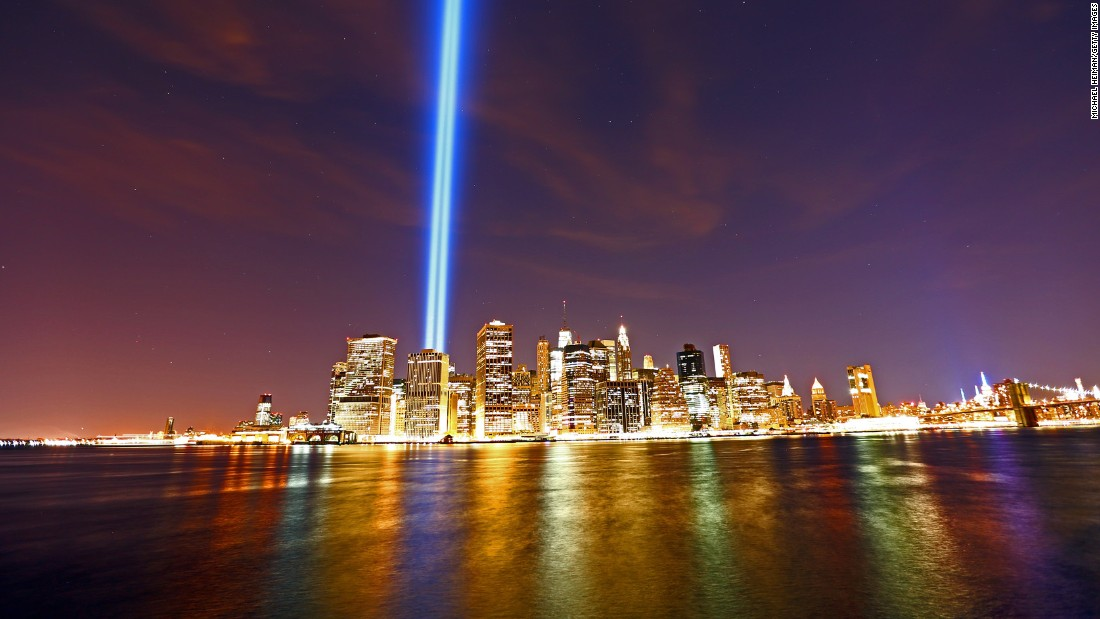 "The ""Tribute in Light"" beams from the skyline of Lower Manhattan where the Twin Towers once stood, as seen from the Brooklyn Heights Promenade on September 11 in New York City. The tribute light commemorates 2,977 people who were killed in New York, at the Pentagon and in Pennsylvania on September 11, 2001."