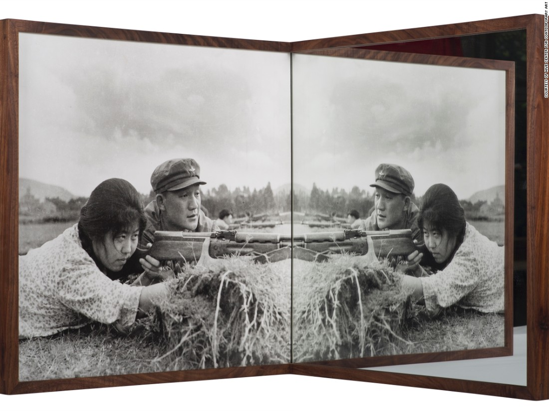 "Cai Dongdong's installation ""Target Practice"" uses a mirror to transform one of the artist's old photographs, changing its original meaning and turning the print into a site of play. ""At the moment I am most concerned about the relationship between images and a society, and how I can use art to express such relationship,"" Cai Dongdong tells CNN."