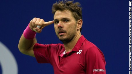 Stan Wawrinka points to his temple on the way to victory over Novak Djokovic  in the men's finals of  the 2016 US Open in New York.