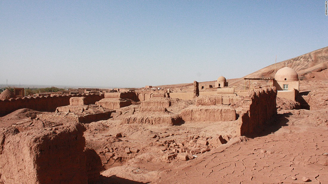 An old Uyghur village made of the flaming red mud and sand of the Taklamakan Desert.