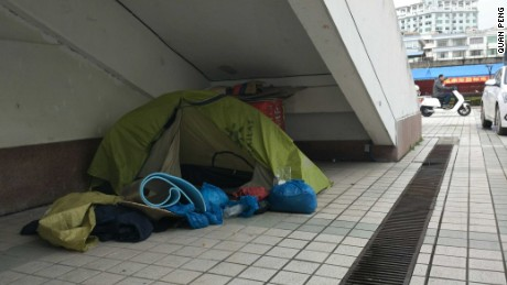 Quan Peng has been sleeping in roadside tents as hotels have rejected him as a guest or weren't wheelchair accessible.