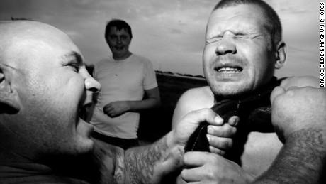 "RUSSIA. 70 kilometers from Yekaterinenburg. 2010. Sergey POLOVTEV, aka ""Kaban"" (wild boar) strangling Alexey LYOHA."