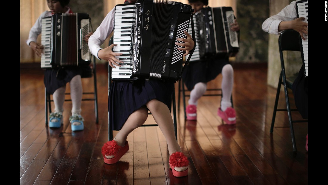 Schoolchildren perform a song during an accordion class. Wong is from Singapore and travels to North Korea about once a month for 10 days at a time, and works with Eric Talmadge, the AP's Pyongyang bureau chief and writer. They also work with a North Korean reporter and photographer.