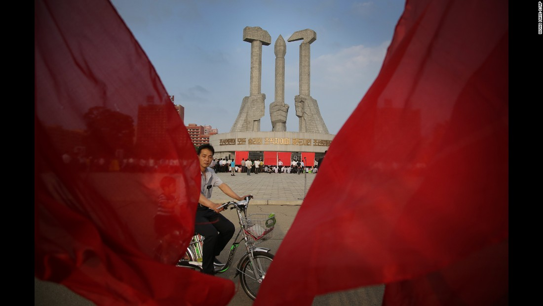 A man cycles past the Workers' Party monument. In January 2012, the AP opened its first bureau in the capital, Pyongyang, and today it is the only US-based media organization that has been allowed to maintain a constant presence in North Korea.