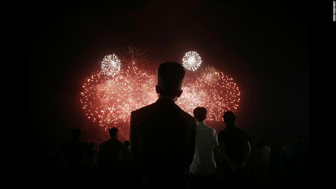 People watch fireworks during celebrations for the 62nd anniversary of the Korean War armistice.