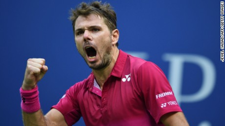 Wawrinka reacts after winning a set against  Djokovic during the US Open final.