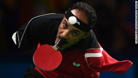 TOPSHOT - Egypt's Ibrahim Hamadtou competes in table tennis at the Riocentro during the Paralympic Games in Rio de Janeiro, Brazil on September 9, 2016. / AFP / CHRISTOPHE SIMON        (Photo credit should read CHRISTOPHE SIMON/AFP/Getty Images)