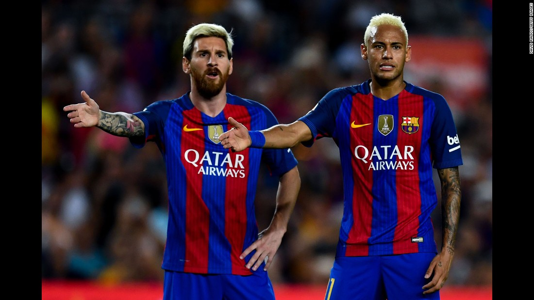 Soccer stars Lionel Messi, left, and Neymar of Barcelona gesture during a match against Deportivo Alaves in Barcelona, Spain, on Saturday, September 10. Deportivo Alaves won 2-1.