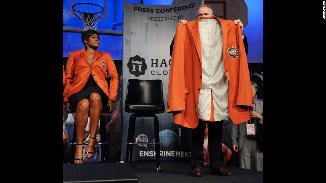 Naismith Memorial Basketball Hall of Fame President and CEO John Doleva holds up the jacket for class of 2016 inductee Yao Ming as Sheryl Swoopes looks on during a news conference in Springfield, Massachusetts, on Thursday, September 8. Allen Iverson, Shaquille O'Neal, Tom Izzo and Jerry Reinsdorf  were also elected to the Hall of Fame.