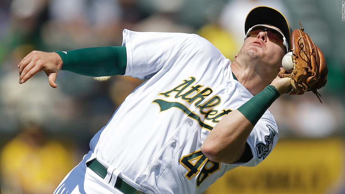 Oakland's Ryon Healy catches the ball in the third inning of a game against Los Angeles in Oakland, California, on Wednesday, September 7. Oakland won 4-1.