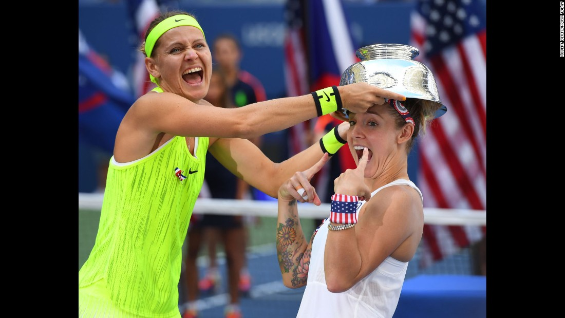 Lucie Safarova, left, and Bethanie Mattek-Sands celebrate after beating Caroline Garcia and Kristina Mladenovic in the US Open doubles final in New York on Sunday, September 11.