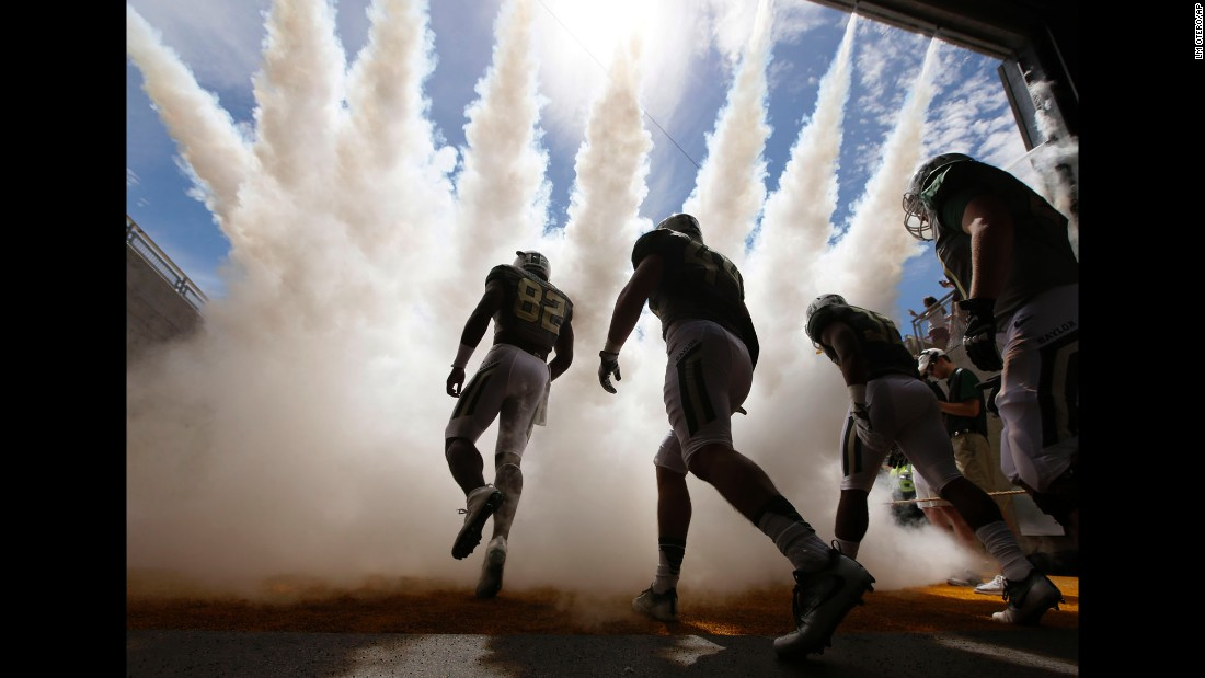 Baylor football players make their way onto the field for a game against Southern Methodist University in Waco, Texas, on Saturday, September 10.
