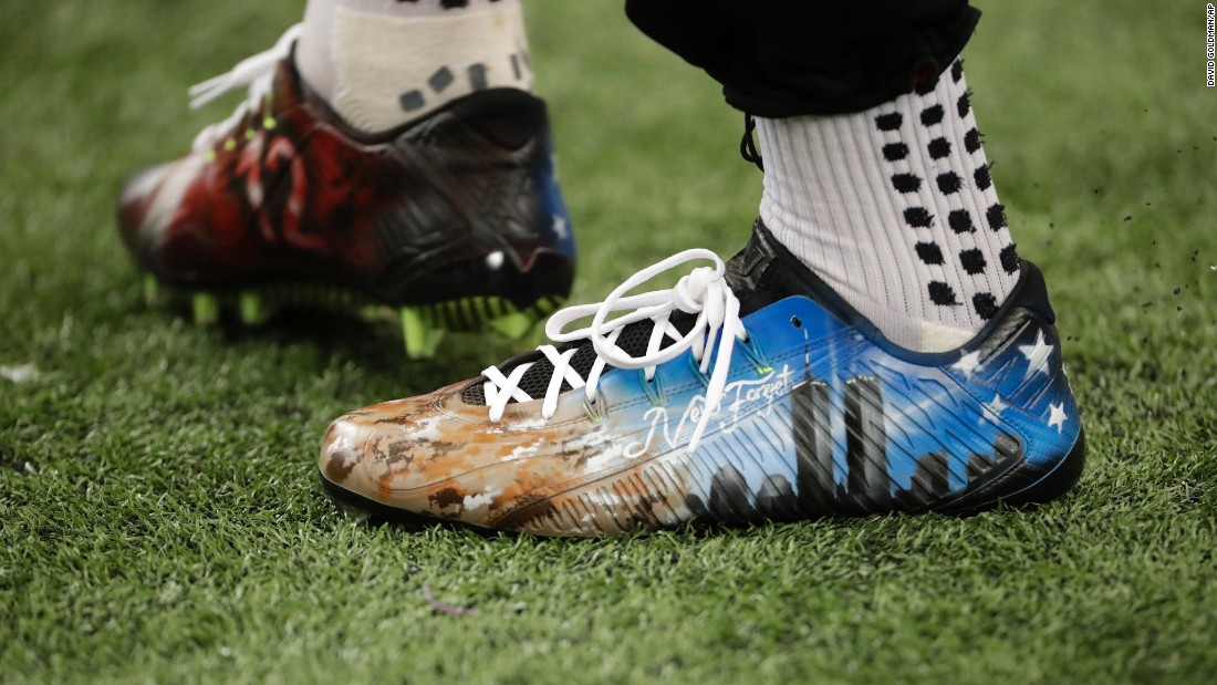 "Atlanta's Julio Jones wears cleats in remembrance of the <a href=""http://www.cnn.com/2016/09/08/us/new-york-9-11-magnum-photographers/index.html"" target=""_blank"">9/11 attacks</a> before the first half of an NFL game against Tampa Bay in Atlanta on Sunday, September 11."