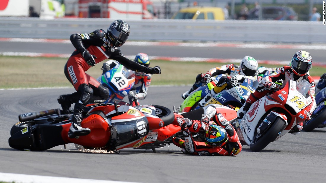 Axel Pons, left, and Xavier Simeon, center, crash on the opening lap of the San Marino Grand Prix in Misano Adriatico, Italy, on Sunday, September 11.