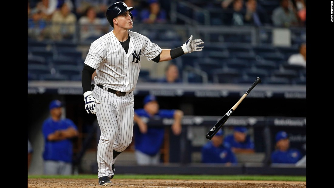 Tyler Austin of the New York Yankees drops his bat after hitting a two-run home run during a game against Toronto in New York on Tuesday, September  6. The Yankees, who have had a difficult start to the season, beat Toronto 7-6.