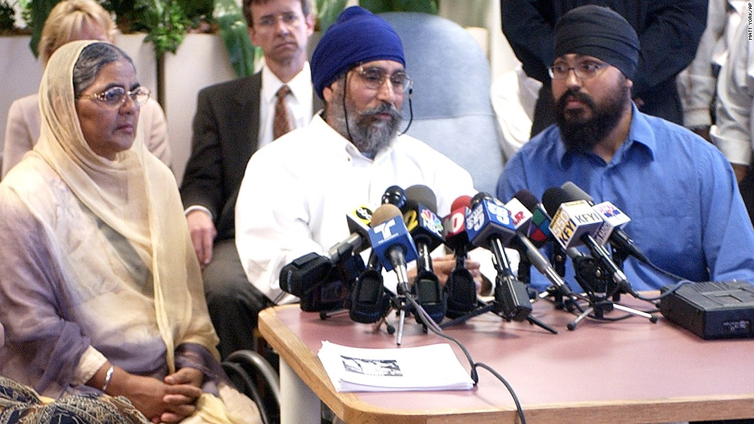 "In 2003, Avtar Singh, center, was shot in his 18-wheeler while waiting for his son to pick him up in Phoenix. The shooter yelled: ""Go back to where you came from."""