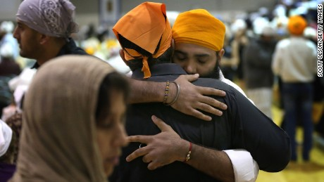 OAK CREEK, WI - AUGUST 10:  Family and friends gather at Oak Creek High School to mourn the loss of  6 members of the Sikh Temple of Wisconsin on August 10, 2012 in Oak Creek, Wisconsin. Bhai Seeta Singh, Bhai Parkash Singh, Bhai Ranjit Singh, Satwant Singh Kaleka, Subegh Singh, and Parmjit Kaur Toor were killed when Wade Michael Page, a suspected white supremacist, went on a shooting rampage at the temple August 5. Page also died at the temple after being shot by police then shooting himself.  (Photo by Scott Olson/Getty Images)