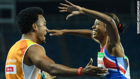 Cuba's Omara Durand celebrates with her guide, Yuniol Kindelan, after winning the women's T12 100-meter.