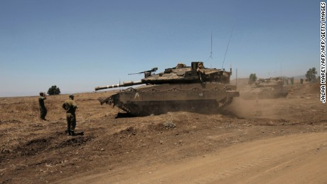 An Israeli tank in the Golan Heights near the Quneitra crossing with Syria in July.