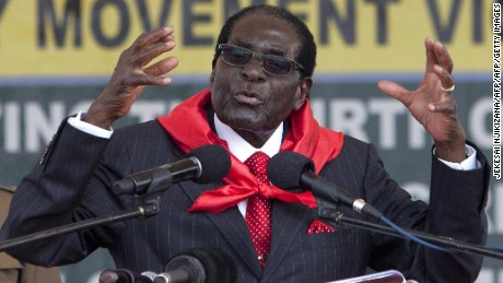 "Zimbabwean President Robert Mugabe delivers a speech on February 28, 2015 during the celebration of his 91st birthday in Victoria Falls. Mugabe celebrated his 91st birthday with a lavish million dollar bash that was slammed by the opposition as ""obscene"" in a country wracked by poverty.The extravagance of Mugabe's birthday parties are a subject of annual controversy in Zimbabwe. AFP PHOTO / JEKESAI NJIKIZANA        (Photo credit should read JEKESAI NJIKIZANA/AFP/Getty Images)"