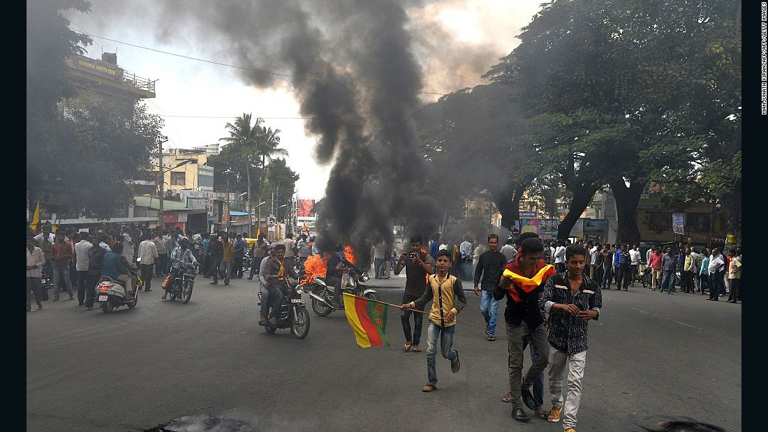 Indian activists burn tires as they blockade traffic on a major connecting road during a statewide strike in Bangalore.