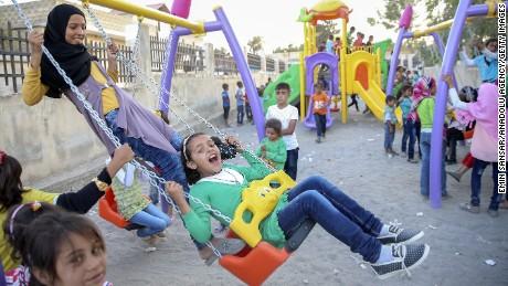 Syrians celebrate Eid Al-Adha in Jarabulus, Syria, on Monday, September 12.