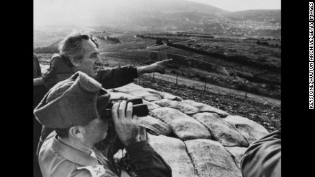 Israeli Minister of Defense Shimon Peres pointing over Northern Israel border towards Lebanon as he meets soldiers during a tour of Lebanese Border Defenses, January 22nd 1976.