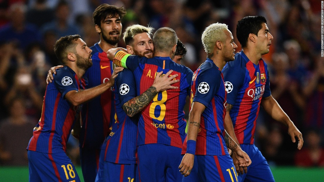 Lionel Messi celebrates one of his three goals as Barcelona recorded its largest Champions League victory when thrashing Celtic 7-0 at Camp Nou.