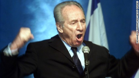 Former Israeli prime minister Shimon Peres makes a passionate plea for the Labor party to join a national unity government with the Likud party during a meeting of the party's central committee in Tel Aviv 26 February 2001. The central committee is debating whether to form a broad-based government with right-wing Prime Minister-elect Ariel Sharon whose main task will be to tackle the seething crisis with the Palestinians.        (Photo credit should read MENAHEM KAHANA/AFP/Getty Images)