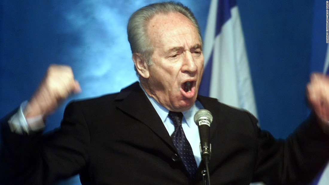 Former Israeli prime minister Shimon Peres makes a passionate plea for the Labor party to join a national unity government with the Likud party during a meeting of the party's central committee in Tel Aviv  February 26, 2001. Peres' leadership spans decades, and generations. He retired from public office in 2014 after the end of his seven-year term as President.