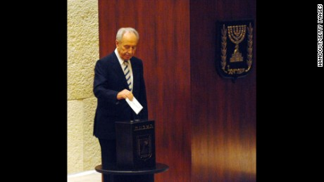 http://www.gettyimages.com/license/542268238JERUSALEM - JUNE 13: (ISRAEL OUT) In this handout image supplied by the Israeli Government Press Office (GPO) Israel's Vice Premier and presidential candidate Shimon Peres casts his ballot during voting at the Knesset, the Israeli parliament, on  June 13, 2007 in Jerusalem, Israel. Peres' two rivals withdrew from the race after Peres won the first round of voting by Israeli lawmakers. As the sole candidate in the second round of voting Peres is set to become Israeli's ninth president. (Photo by GPO via Getty Images)