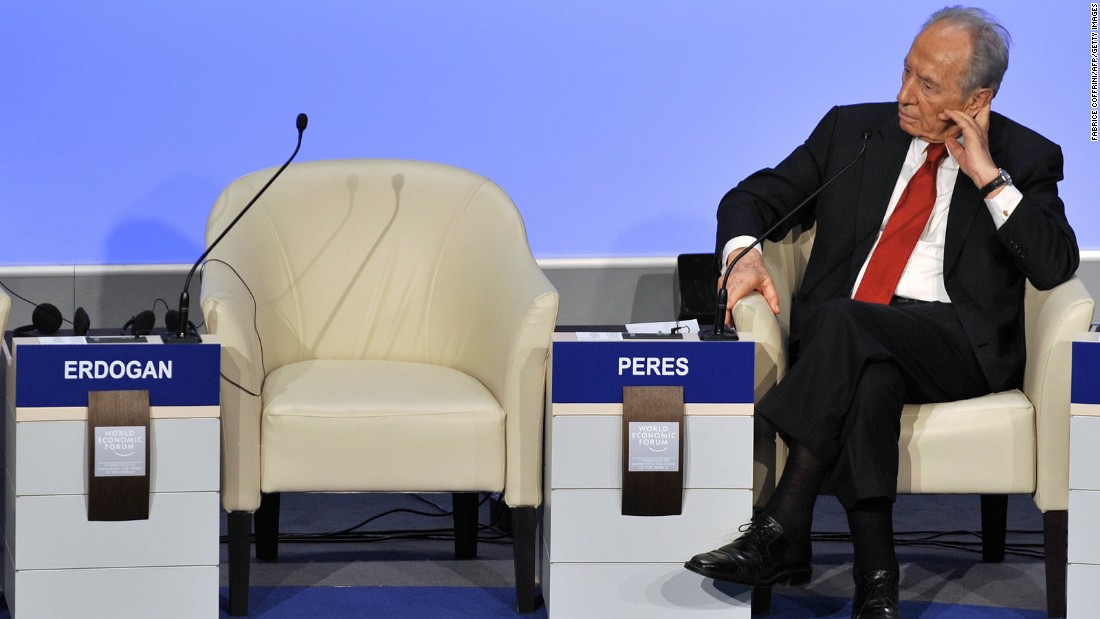 Israeli President Shimon Peres beside the empty seat of Turkish Prime Minister Recep Tayyip Erdogan after Erdogan stormed out of a debate with Peres about the three-week Gaza War at the World Economic Forum in Davos, Switzerland, on January 29, 2009.