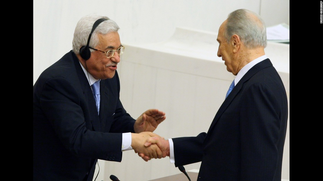 Palestinian Authority President Mahmoud Abbas, left, congratulates President Shimon Peres of Israel after Peres addressed Turkey's Parliament in Ankara on November 13, 2007, becoming the first Israeli President to speak to a Muslim country's legislature.