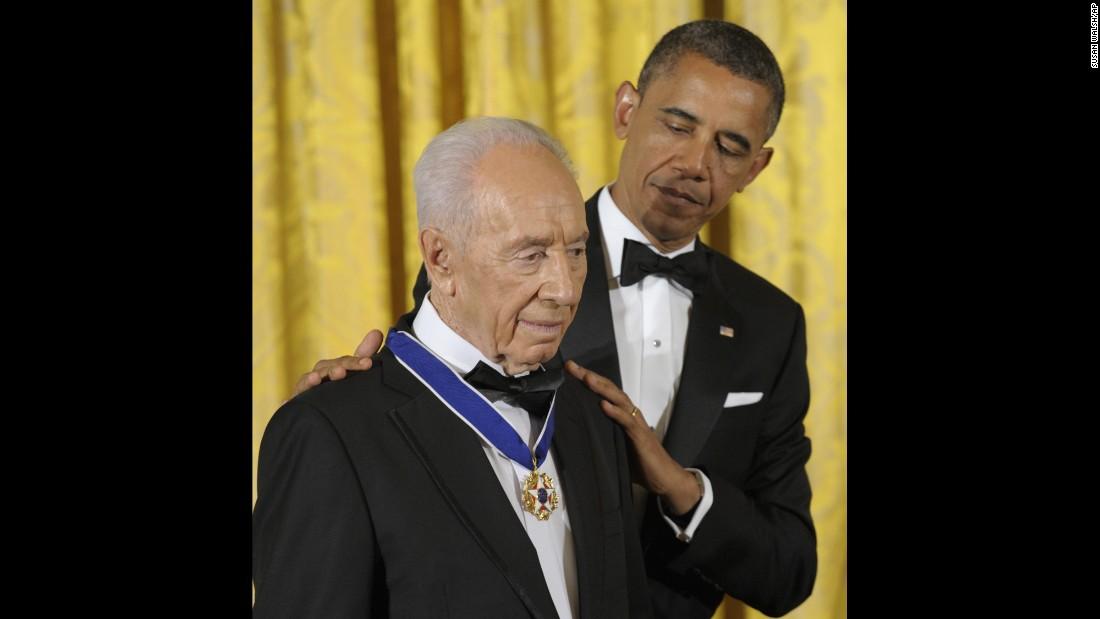 President Barack Obama awards Israeli President Shimon Peres the Presidential Medal of Freedom, the nation's highest civilian honor, at the White House on June 13, 2012.