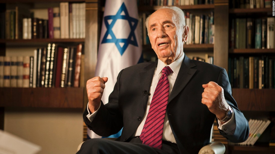 Israeli President Shimon Peres speaks during an interview with the Associated Press at his residence in Jerusalem on July 15, 2014.