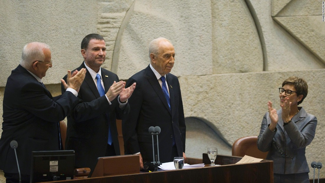 Newly sworn-in Israeli President Reuven Rivlin, left, and Parliament Speaker Yuli Edelstein applaud outgoing President Shimon Peres during a ceremony at the Knesset, Israel's parliament, in Jerusalem on July 24, 2014. Rivlin succeeded Peres, who had promoted peace throughout his long career but whose term ended as Israel was fighting Hamas in Gaza.
