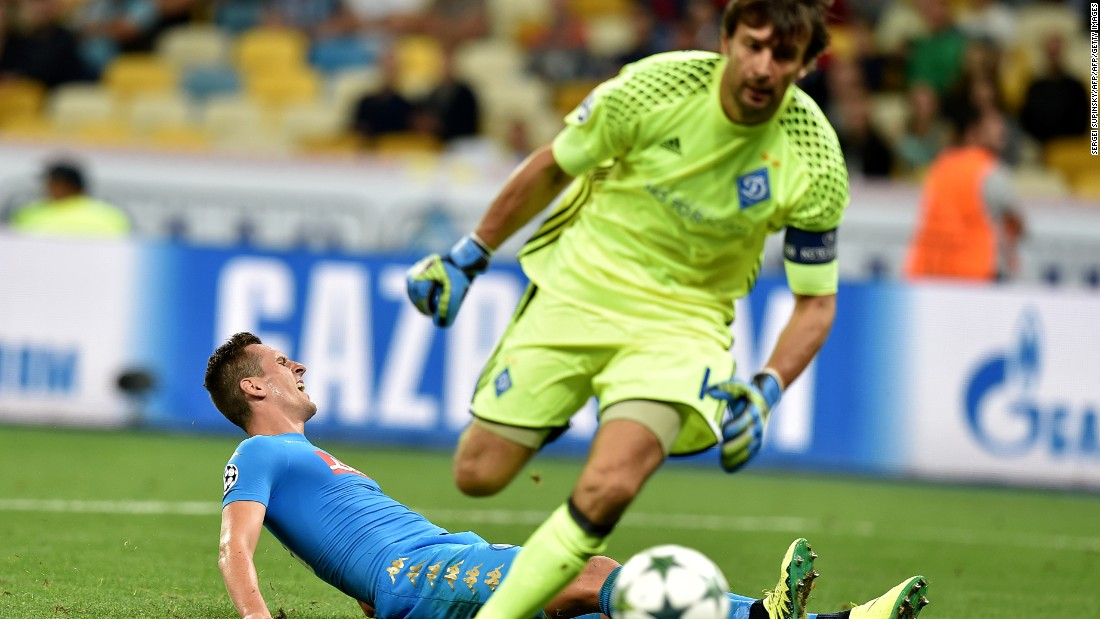 Dynamo Kiev goalkeeper Olexandr Shovkovskiy made history by becoming the second oldest player to contest a Champions League match but he was beaten twice by Arkadiusz Milik, pictured on the floor, as Napoli won 2-1.
