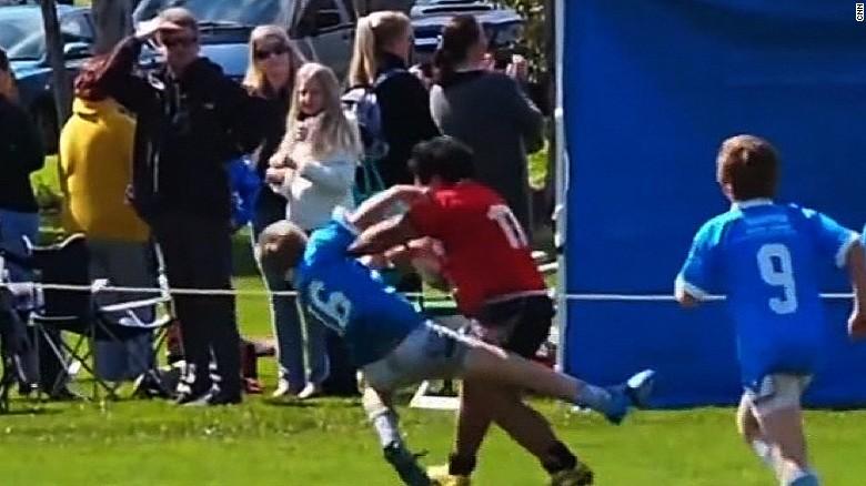 Watch boy plow through rugby rivals