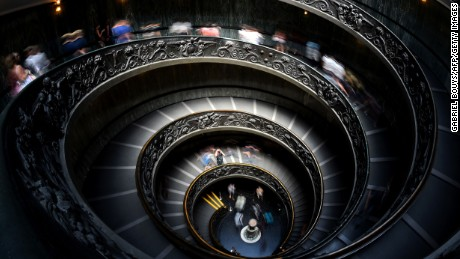 Visitors leave the Vatican Museums, at the Vatican on July 30, 2015, using the spiral stairs designed by Giuseppe Momo in 1932. AFP PHOTO / GABRIEL BOUYS / AFP / GABRIEL BOUYS        (Photo credit should read GABRIEL BOUYS/AFP/Getty Images)