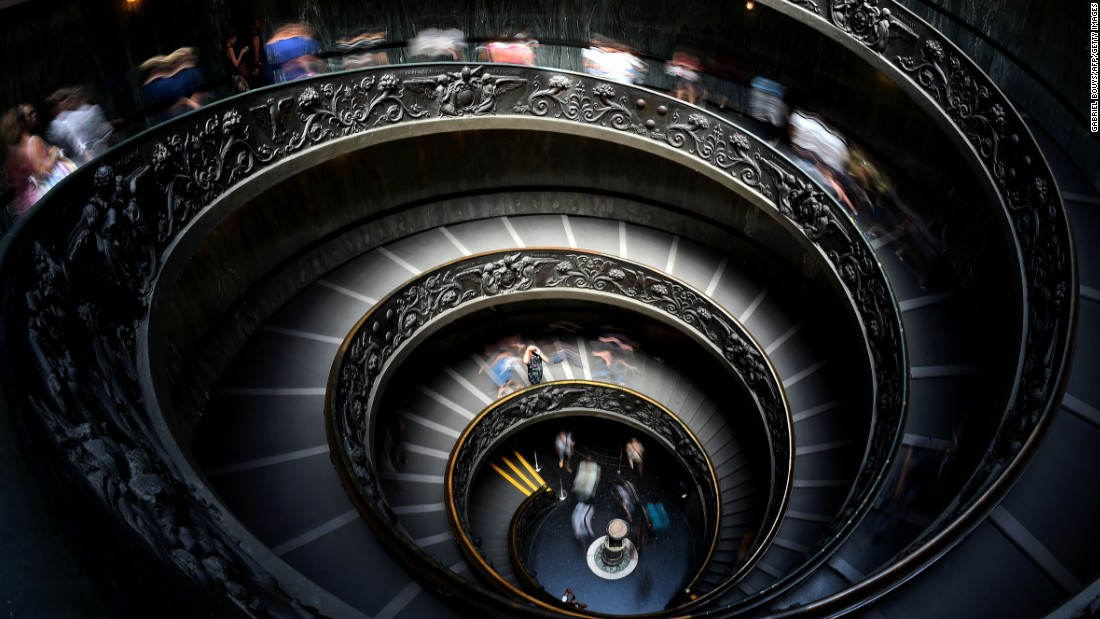 """Visitors to the Vatican Museums traverse this beautiful """"Bramante"""" staircase. It was designed as a double-helix -- so people ascending do not meet people descending -- by Giuseppe Momo in 1932."""