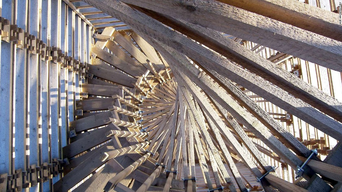 The circular rotation of the staircase slightly sticks out of the structure's sides.