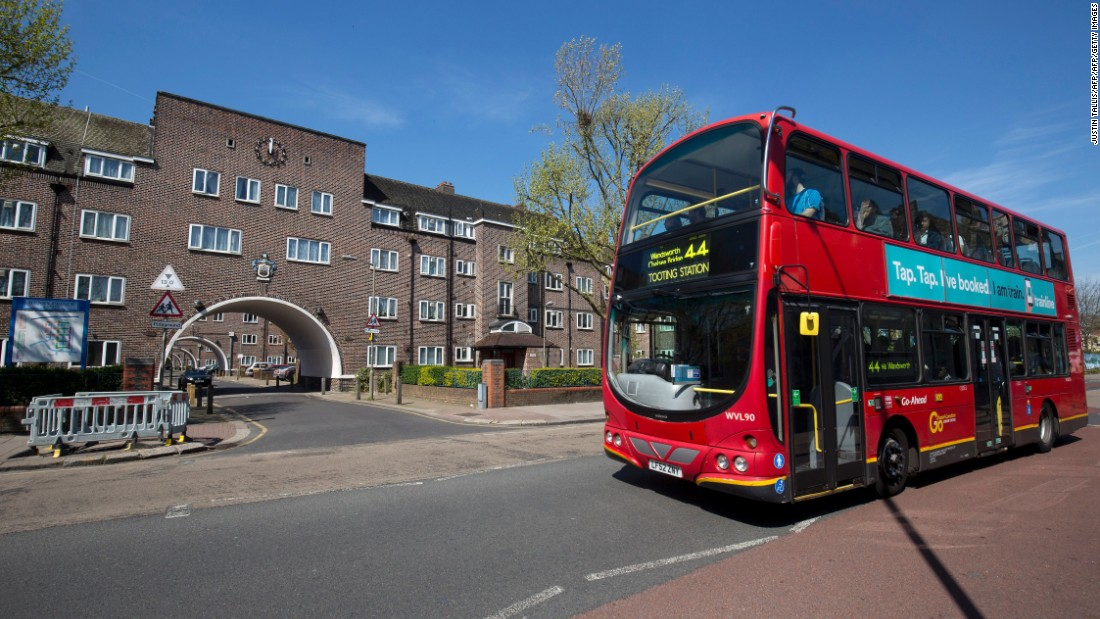 The Khans' late father drove the No. 44 bus, which is seen passing the Henry Prince Estate in south London, where the boys grew up.