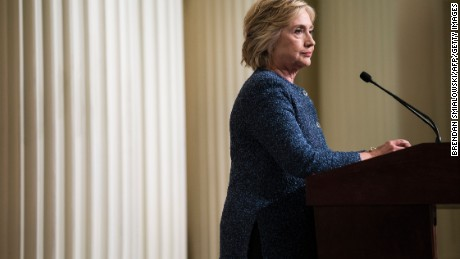Democratic presidential nominee Hillary Clinton listens to a question while speaking to the press after a working session with national security advisers and experts at the New York Historical Society September 9, 2016 in New York, New York