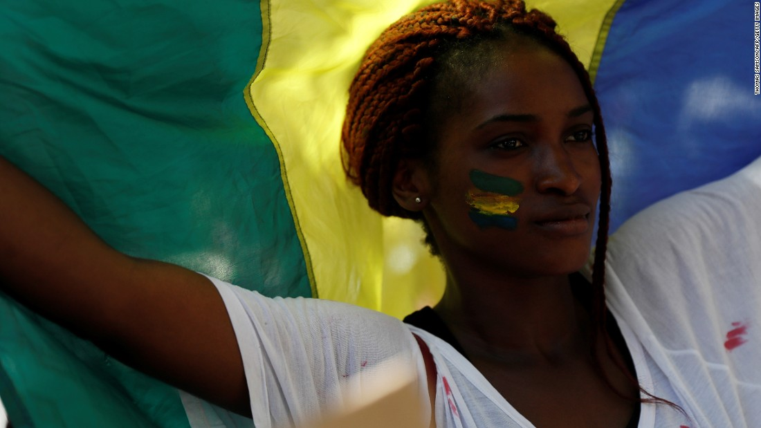 """The results, released  August 31, show that Bongo won 49.8% of the vote, while Jean Ping, the opposition leader, had 48.23%. Ping and his supporters <a href=""""http://edition.cnn.com/2016/09/10/africa/gabon-election-ping-court-challenge/"""" target=""""_blank"""">say the numbers are fraudulent</a> and demand a recount. This sparked protests in France too. Pictured here, a woman waves a Gabonese flag during a demonstration in Paris in September."""