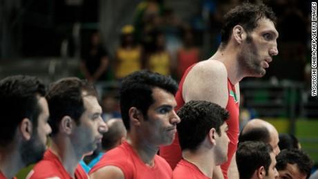Morteza Mehrzadselakjani, known as Merzhad, lines up alongside his Iranian teammates.