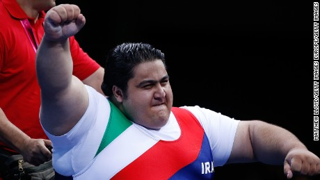 Siamand Rahman celebrates after winning gold at London 2012.