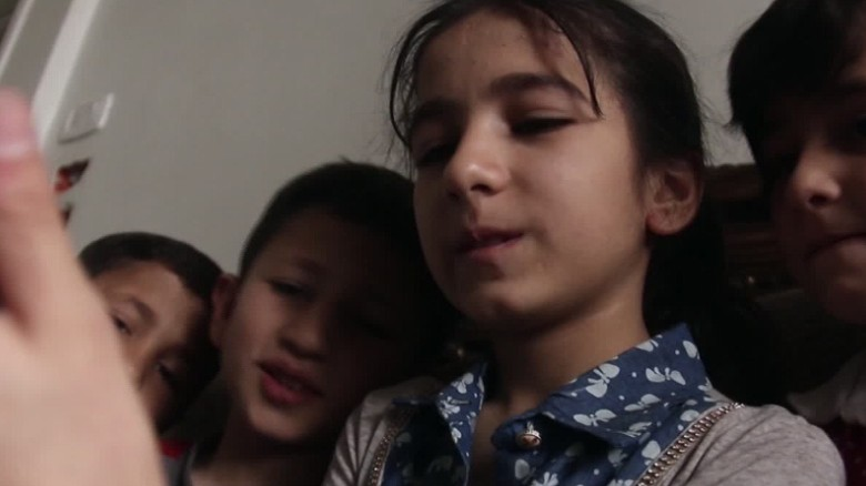 Doha and her brothers and sisters keep in touch with Yasmin through video calls.