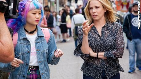 Chelsea Handler navigates the famous Takeshita Street in Harajuku with her guide, fashion blogger, Elleanor Yamaguchi. (Photo: Geoff Johnson/Netflix)
