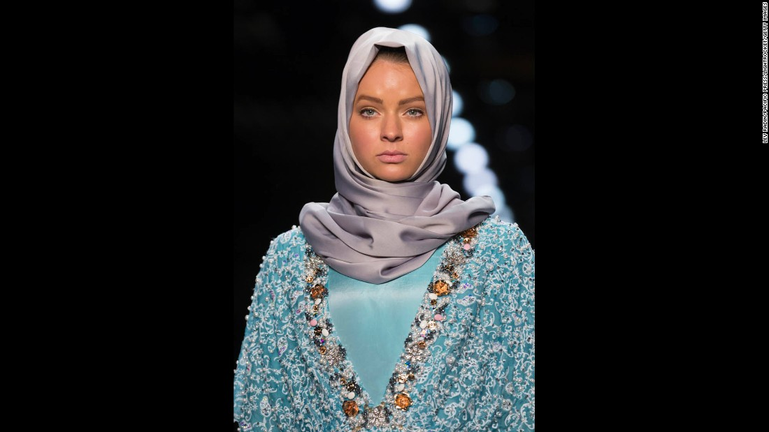 In Hasibuan's collection, the hijabs were paired with eye-catching gowns, suits, kimonos and tunics in colorful silks, velvets and brocades, adorned with sequins and pearls.