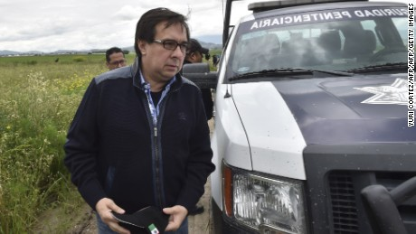"""The director of the Criminal Investigation Agency, Tomas Zeron, arrives at the house at the end of the tunnel through which Mexican drug lord Joaquin """"El Chapo"""" Guzman could have escaped from the Altiplano prison, in Almoloya de Juarez, Mexico, on July 12, 2015. Guzman has escaped from a maximum-security prison, the government said Sunday, his second jail break in 14 years. The kingpin was last seen in the shower area of the Altiplano prison in central Mexico late Saturday before disappearing. """"The escape of Guzman was confirmed"""", the National Security Commission said in a statement.  AFP PHOTO / YURI CORTEZ        (Photo credit should read YURI CORTEZ/AFP/Getty Images)"""